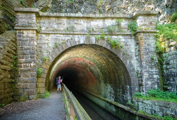 man with backpack in Paw Paw Tunnel C&O canal towpath
