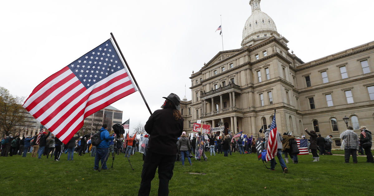 Michigan bans openly carrying guns at polling places on Election Day – CBS News