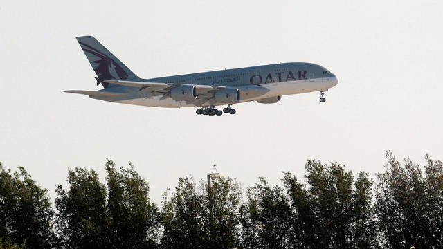 FILE PHOTO: Qatar Airways Airbus A380 plane is seen over Doha