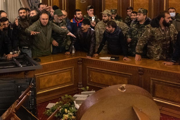 Protesters react inside the parliament in Yerevan
