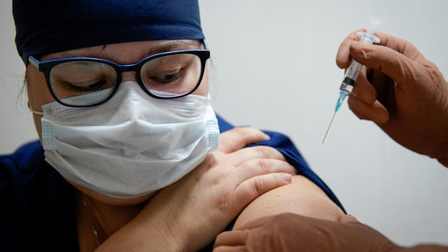 "FILE PHOTO: FILE PHOTO: A medic of the regional hospital receives  Russia's ""Sputnik-V"" vaccine shot against the coronavirus disease (COVID-19) in Tver"
