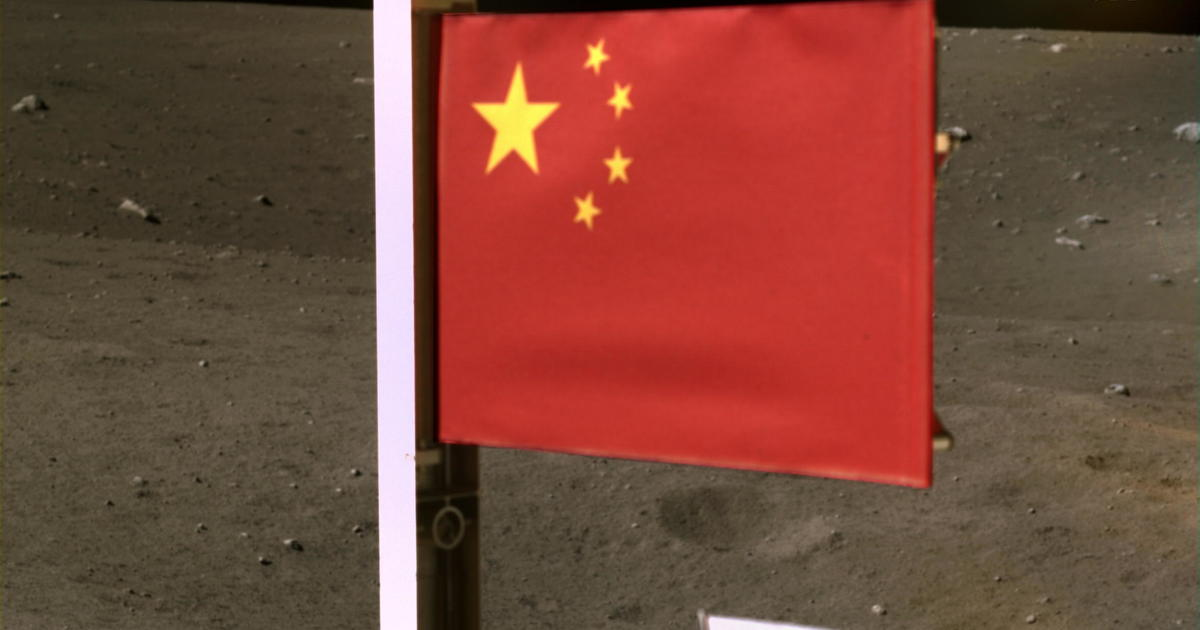 China releases image of its flag on the moon as spacecraft carrying lunar rocks lifts off