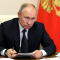 Russia's President Vladimir Putin chairs a meeting outside Moscow