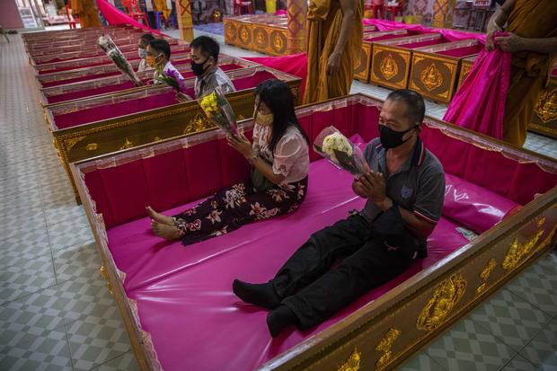 Thai People Lie In Coffins To Welcome The New Year