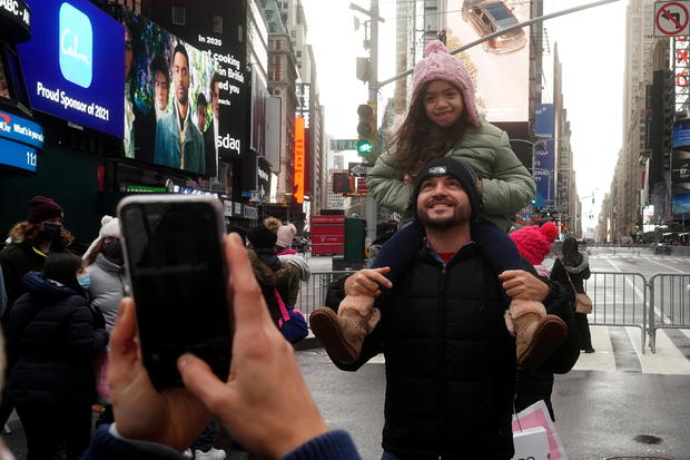 People take a photo in Times Square ahead of New Year's Eve