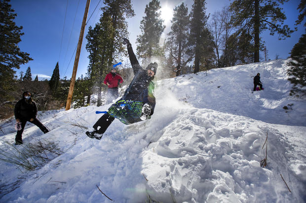 SoCal residents play in the snow from recent storms
