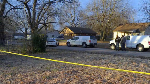 Crews work the scene after a deadly shooting at a house in Muskogee, Oklahoma, February 2, 2021.