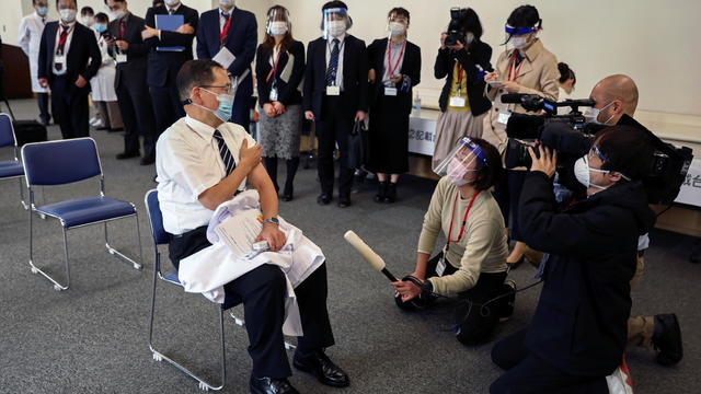 Director of the Tokyo Medical Center Kazuhiro Araki speaks to the media after receiving a dose of the coronavirus disease (COVID-19) vaccine as Japan launches its inoculation campaign, in Tokyo