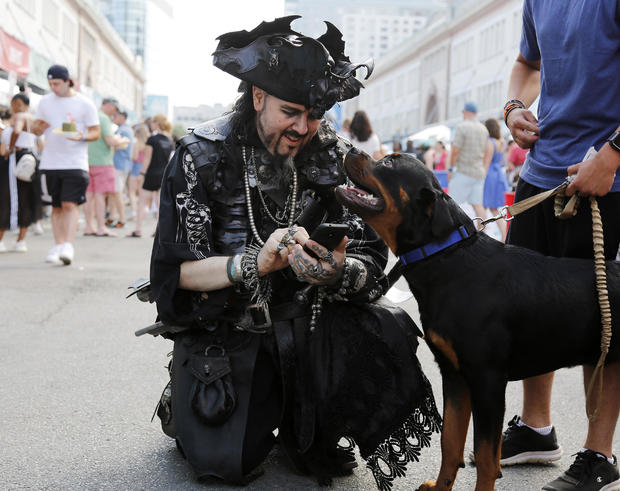 BOSTON, MA. - AUGUST 4: Ashton Synn, of Braintree, a pirate with Rogues' Armada, prepares to take a selfie with a dog named Zeus at the Boston Seafood Festival on August 4, 2019 in Boston, Massachusetts. (Photo By Mary Schwalm/MediaNews Group/Boston Heral