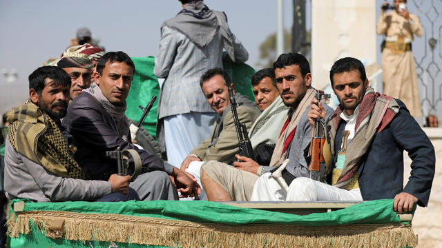 FILE PHOTO: Armed Houthi followers ride on the back of a truck after participating in a funeral of Houthi fighters killed in recent fighting against government forces in Yemen's oil-rich province of Marib, in Sanaa, Yemen