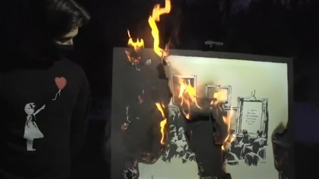cbsn-fusion-crypto-enthusiasts-burn-and-digitize-banksy-artwork-dan-patterson-2021-03-04-thumbnail-661127-640x360.jpg