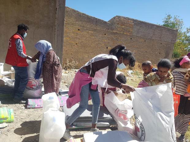 Workers from the International Committee of the Red Cross (ICRC) and volunteers from the Ethiopian Red Cross, distribute relief supplies to civilians in Tigray region