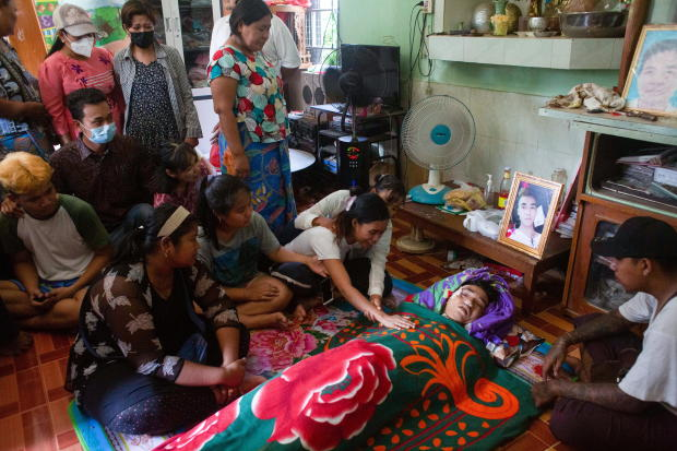People attend the funeral of Chit Min Thu, who died in an anti-coup protest in North Dagon Township in Yangon