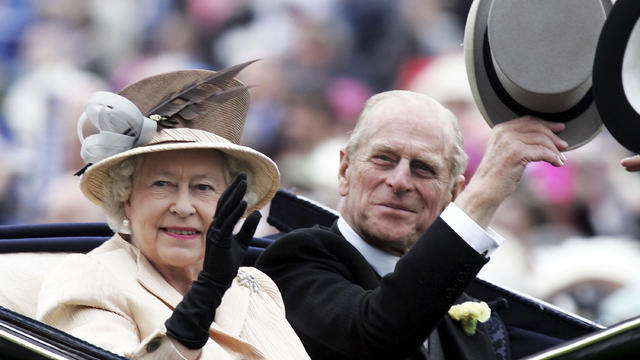 Queen Elizabeth II and husband Prince Philip, Duke of Edinburgh, arrive on the third day of Royal Ascot at York Racecourse on June 16, 2005, in York, England.