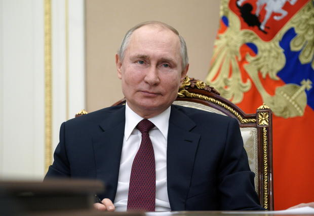 Russian President Vladimir Putin takes part in a video conference in Moscow