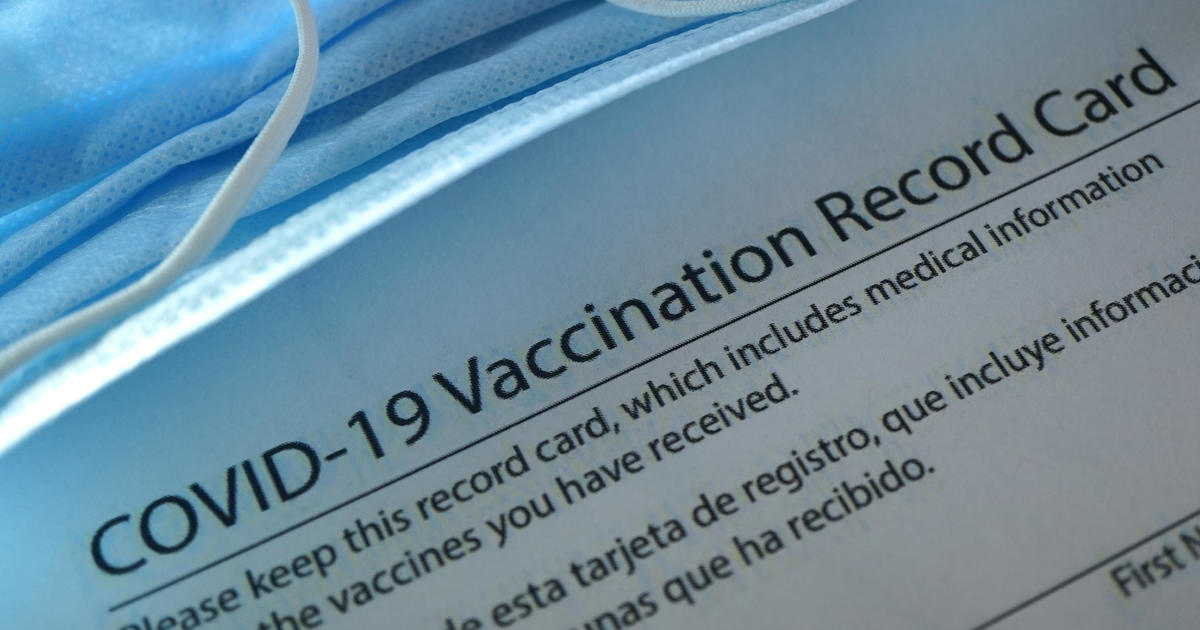 You've been vaccinated. So what should you do with your vaccine record card? - CBS News