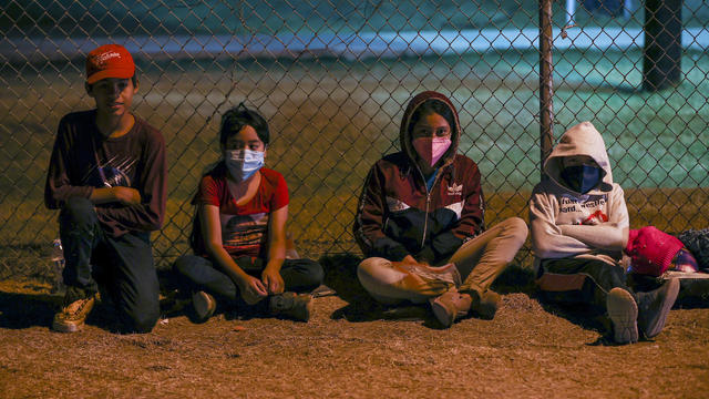 Migrants cross into Texas from Mexican border