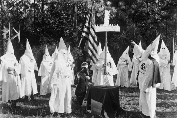 Klansman Holding Cross at Ku Klux Klan Ceremony