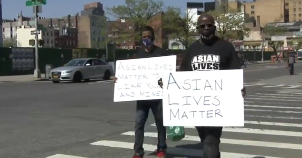 Group marches in support of Asian man hospitalized after brutal attack in New York City – CBS News