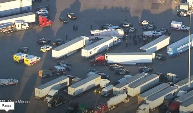 ta-trcuk-stop-in-san-antonio-where-dozens-of-people-potentially-migrants-being-smuggled-fled-back-of-big-rig-050621.jpg