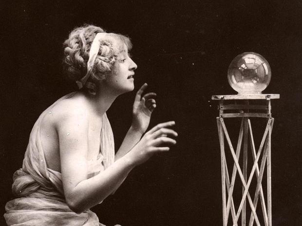 Woman Kneels Before Crystal Ball