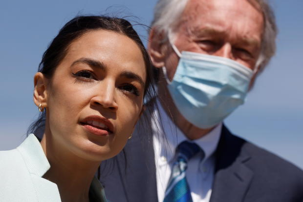 U.S. Representative Ocasio-Cortez and Senator Markey lead a news conference to re-introduce the Green New Deal at the U.S. Capitol in Washington