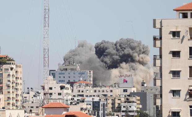 Smoke rises after Israeli forces destroyed a building in Gaza City where Al-Jazeera and The Associated Press had their offices, on May 15, 2021.  MUSTAFA HASSONA/ANADOLU AGENCY VIA GETTY IMAGES