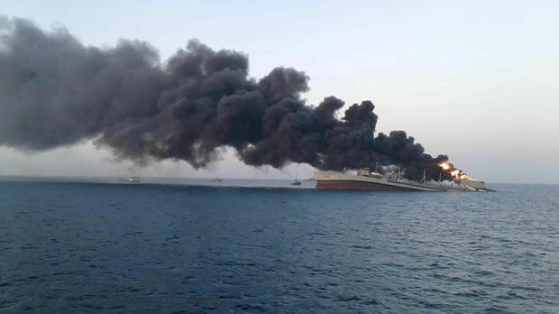 Smoke rises from Iran navy's largest ship in Jask port in the Gulf