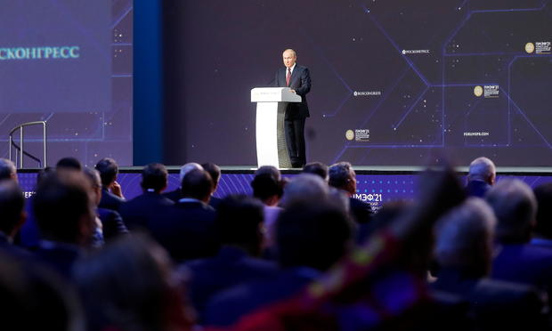 Russian President Putin delivers a speech during a session of the St. Petersburg International Economic Forum
