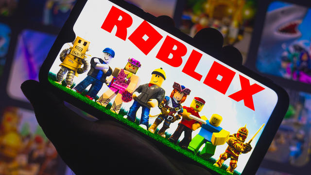 In this photo illustration Roblox logo seen displayed on a