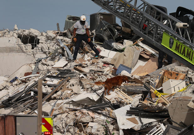 Search and rescue worker in rubble of collapsed building