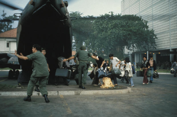Americans and dependents board helicopter inside US Embassy during Fall of Saigon April 1975