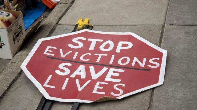 """Octagon reading """"Stop Evictions, Save Lives"""""""