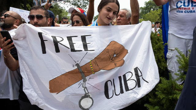 Cuban-American demonstrators hold a protest for Cuban rights near the White House in Washington
