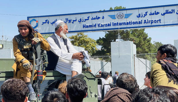 Thousands of Afghans rush to the airport in Kabul
