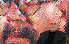US artist Chuck Close sits in front of o