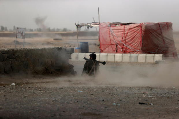 An Afghan soldier fires a rocket-propelled grenade in a clash close to Spin Boldak in Kandahar province, Afghanistan