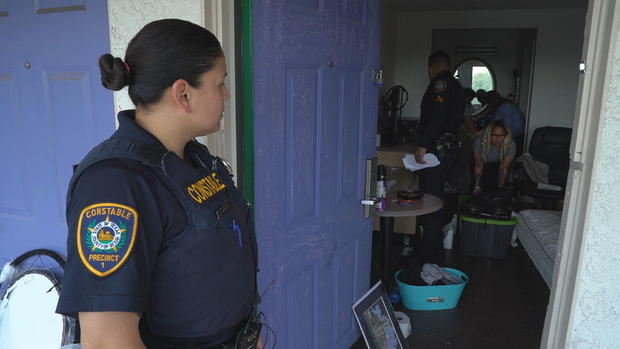 deputy-valencia-keeps-watch-as-crews-clear-the-apartment.jpg