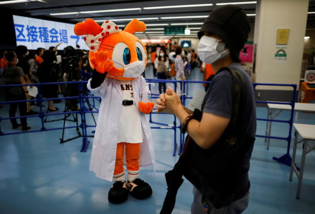 Sister Giabbit, a mascot of the Japanese professional baseball team Yomiuri Giants, greets people at Tokyo Dome in Tokyo