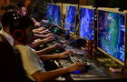 FILE PHOTO: People play online games at an internet cafe in Fuyang
