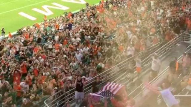miami-hurricanes-fans-use-american-flag-as-net-to-help-save-falling-cat-at-hard-rock-stadium-091121.jpg