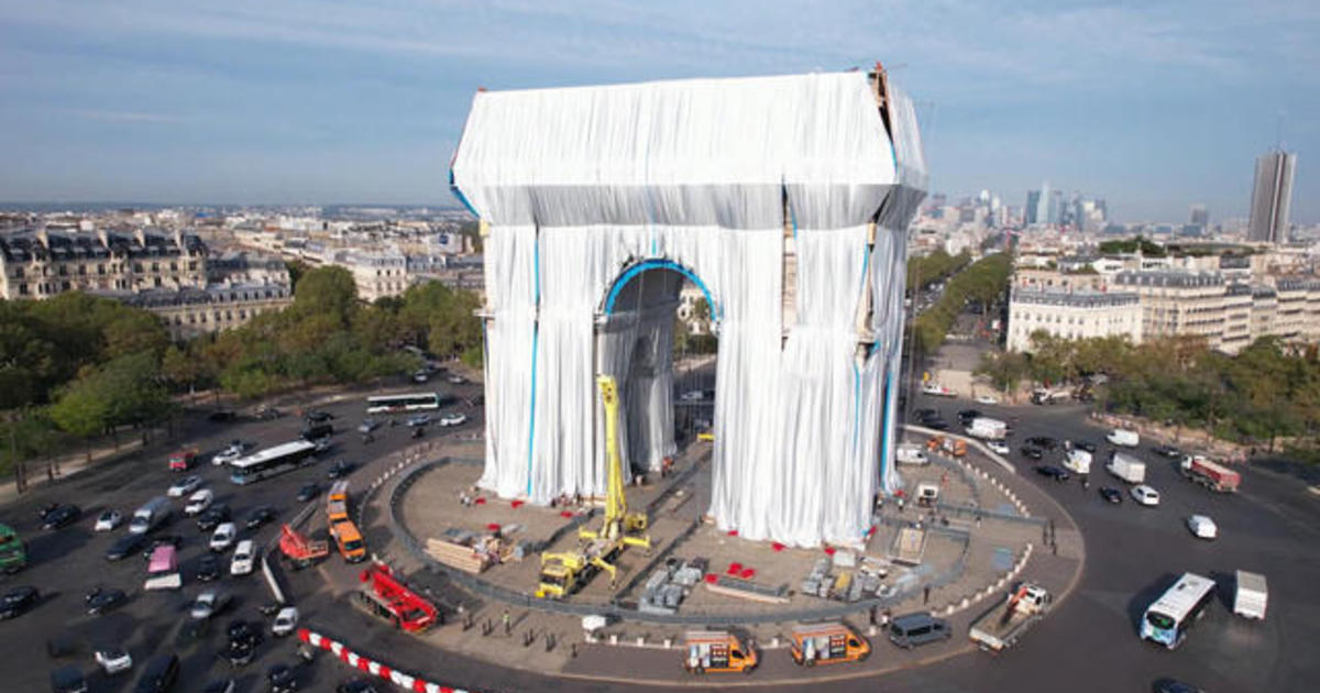 Artistic work conceived in 1962 is finally realized as Paris' Arc de Triomphe is wrapped in fabric
