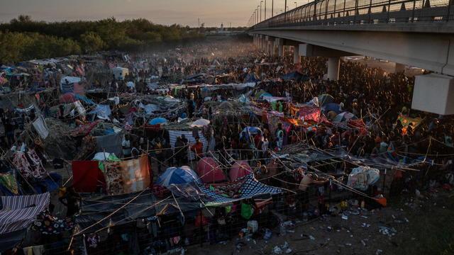 Migrants shelter near Del Rio International Bridge in Del Rio, Texas