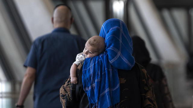 Afghanistan Refugees Arrive at Dulles International Airport
