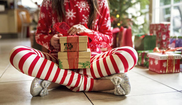 Cute Young Girl Sitting With Christmas Presents