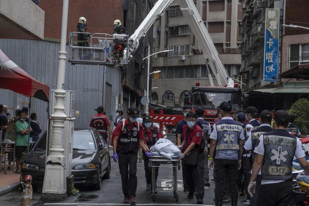 """Fierce"""" fire guts Taiwan apartment building, killing almost 50 - CBS News"""