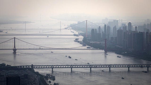 Bridges over the Yangtze River are seen from the Wuhan Greenland center during its construction August 11, 2020, in Wuhan, China.