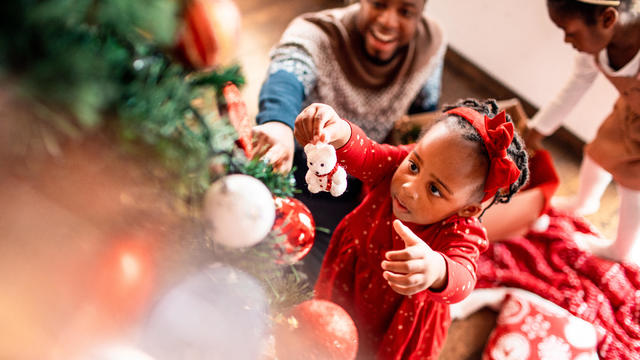 Kids decorating the Christmas tree with their Dad